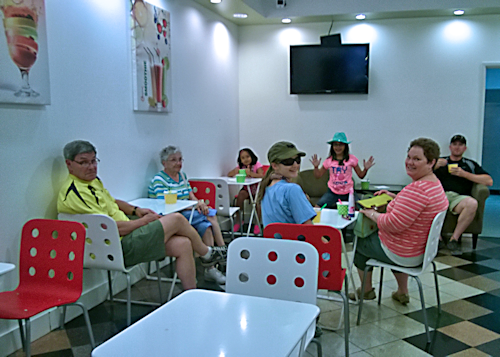 Family Hanging Out at Frozen Yogurt Place
