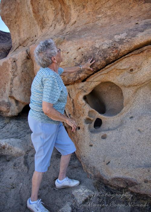 Grandma looking at rock