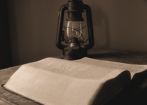 Bible with Oil Lamp