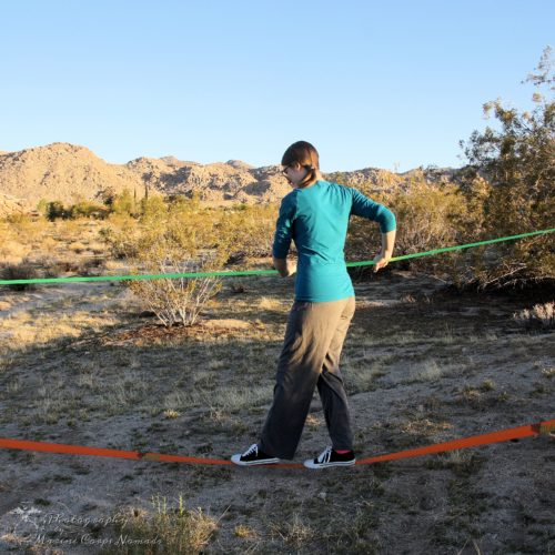 Munchkin figuring out the slackline