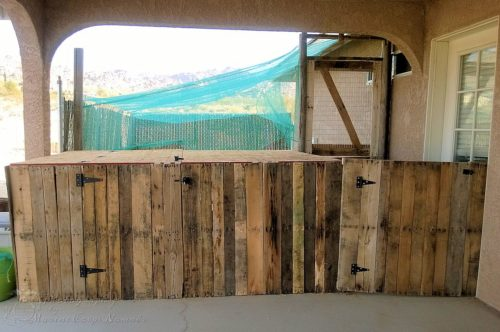 Gated chicken area made from pallets as well as the split chicken run door