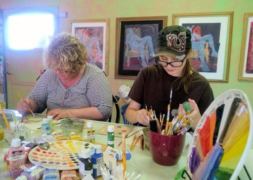 Munchkin painting pottery with Grandma