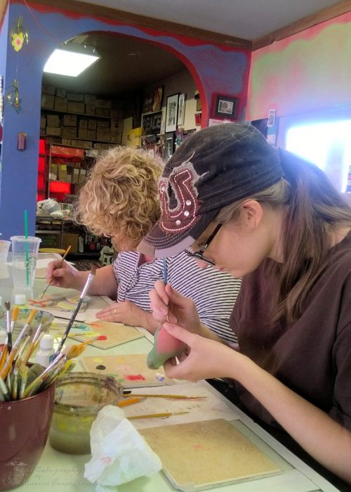 Munchkin and Grandma painting their pottery