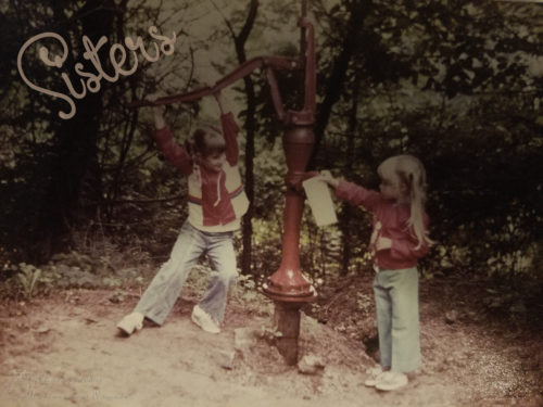 Helping my sister at the waterpump when we were little