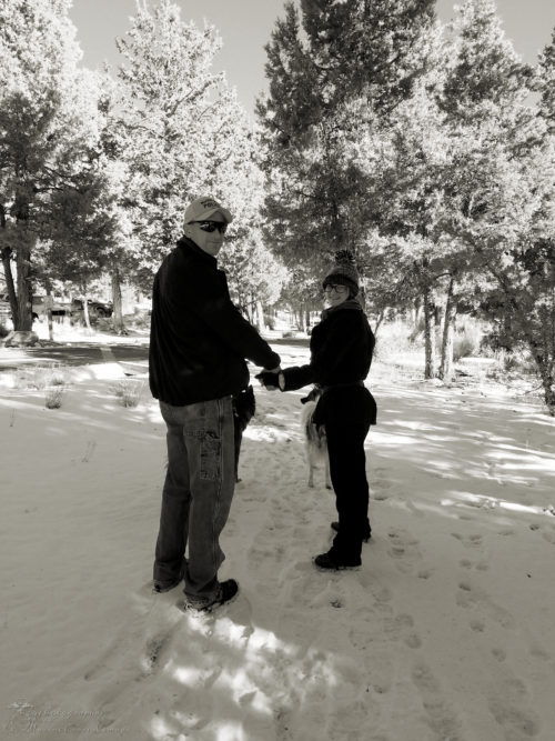 Daddy and daughter hand-in-hand hiking in the snow in Big Bear